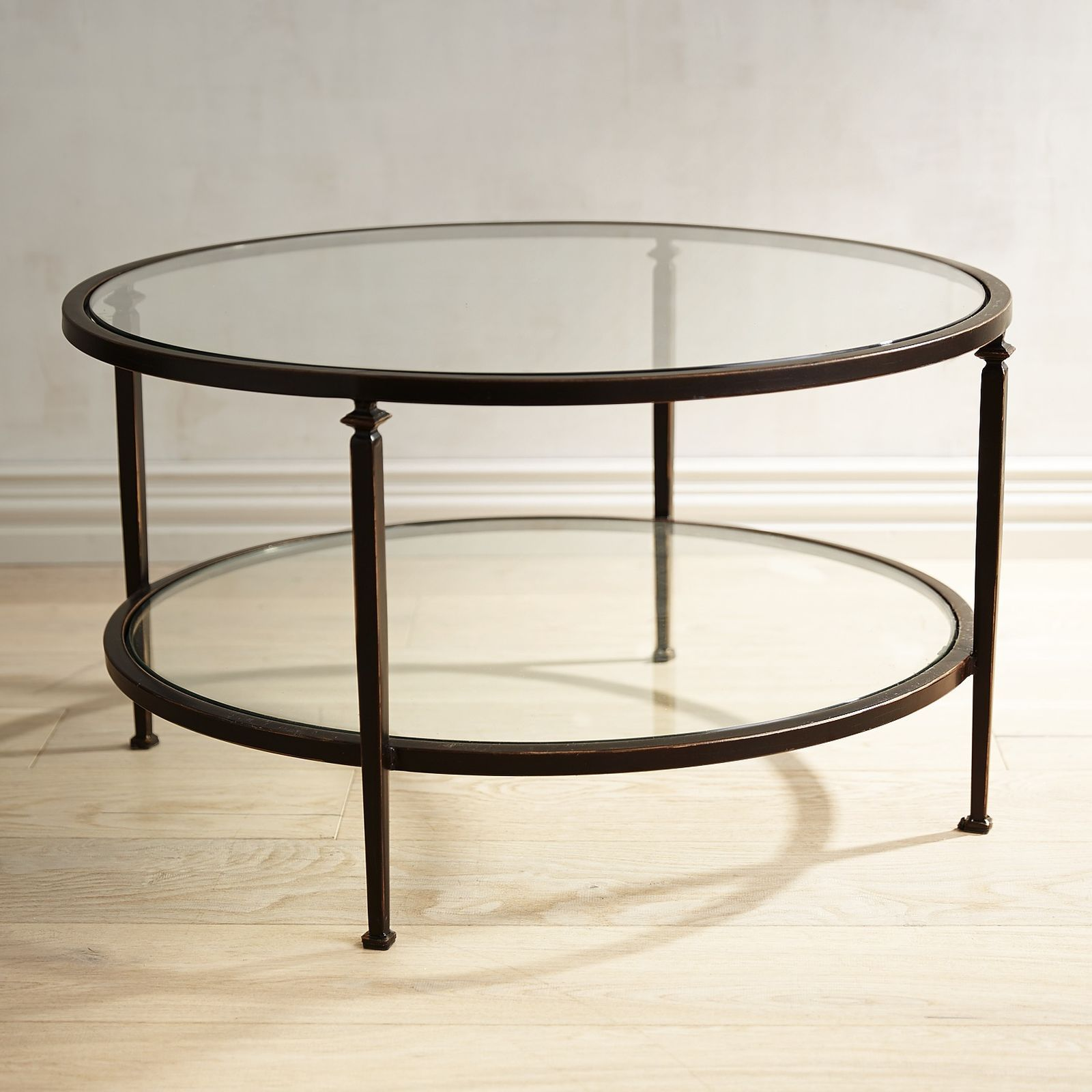 lincoln tempered glass top round coffee table inspiration office end tables and our has slender bronze wrought iron frame clear adding visual space your room weathered oak stain