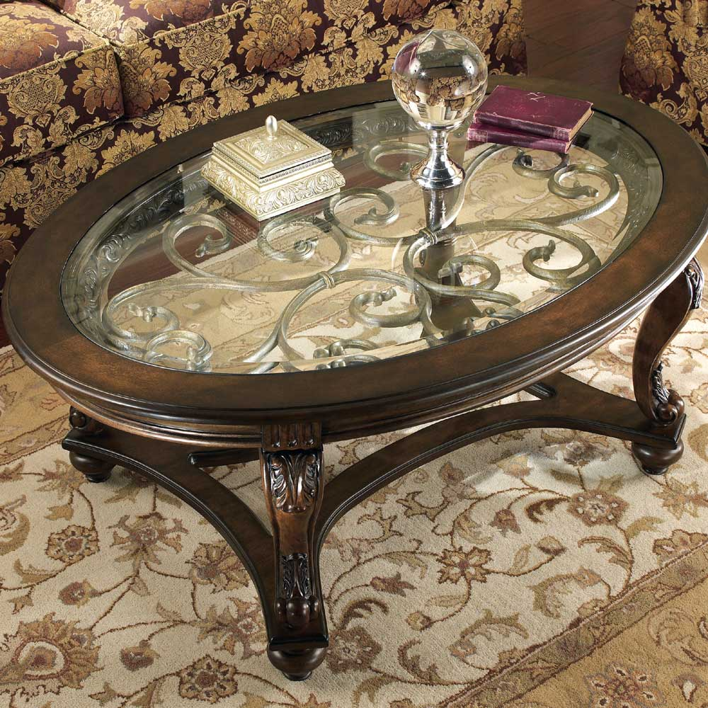 norcastle oval cocktail table with glass top rotmans products ashley color brown end tables best lamps ethan allen french country legacy collection cool nic narrow console drawers