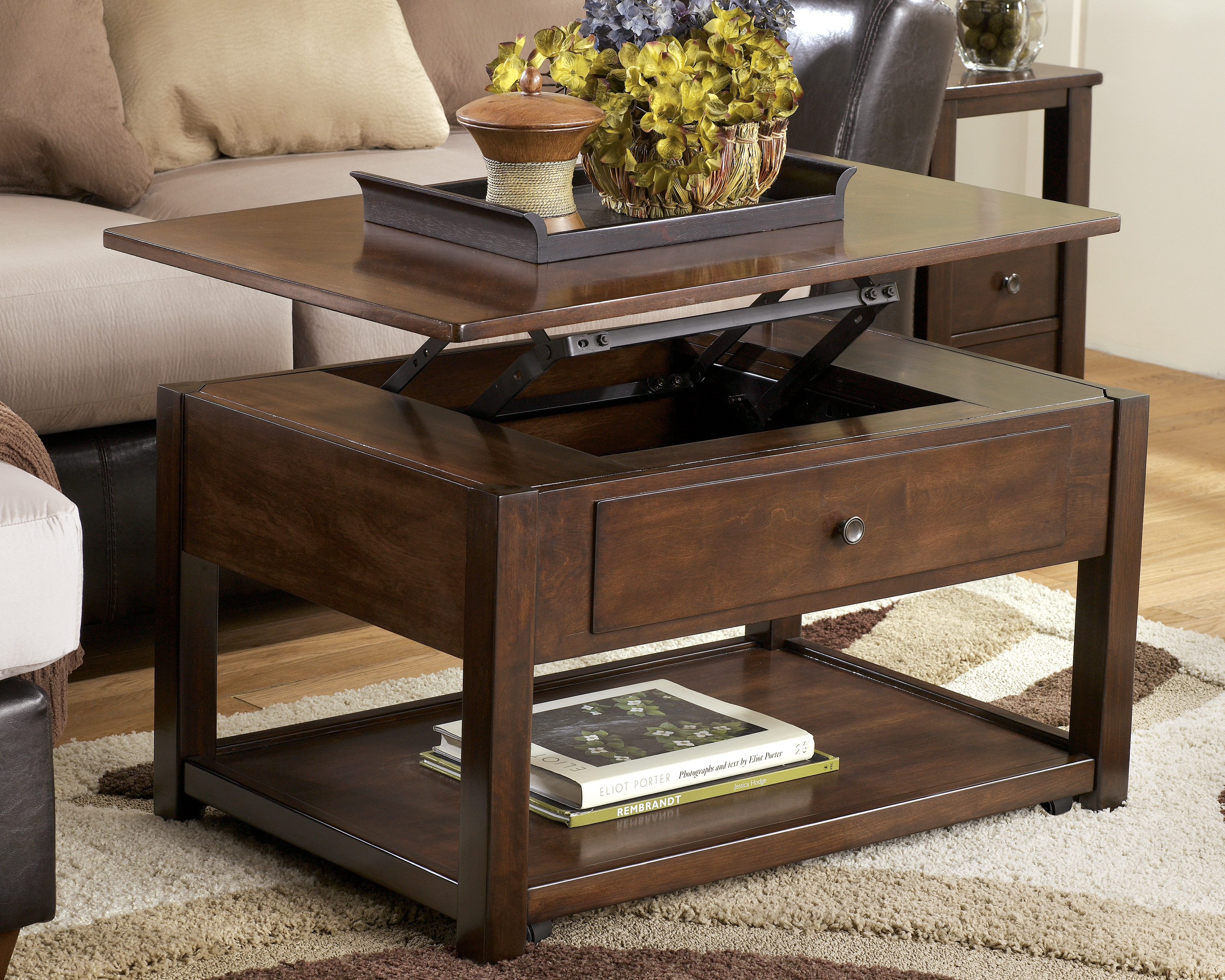 tier end table the outrageous cool ashley home furniture lift top coffee tables open iron glass three piece living room set inch high nightstand wood plank wall mounted bathroom