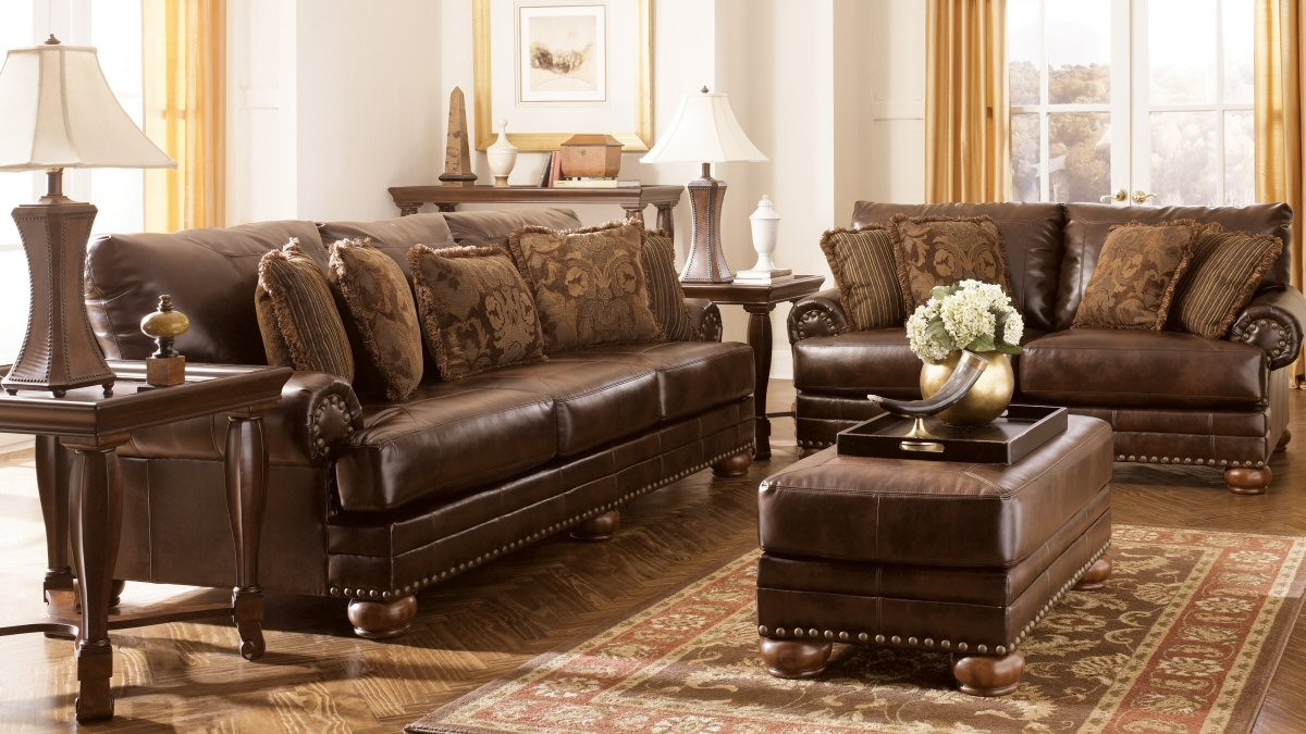 traditional living room with ashley furniture dark brown leather sofa ott coffee table caley poly lamps wooden end tables for couch classic style sectional set and espresso