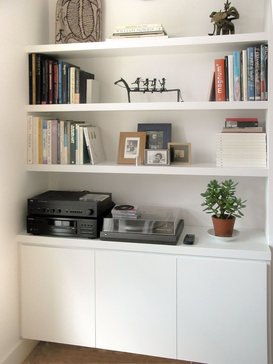 alcove storage idea plain white like the bottom handless doors thick floating shelves but would uneven open boxes set above then another cupboard top kitchen items command hook