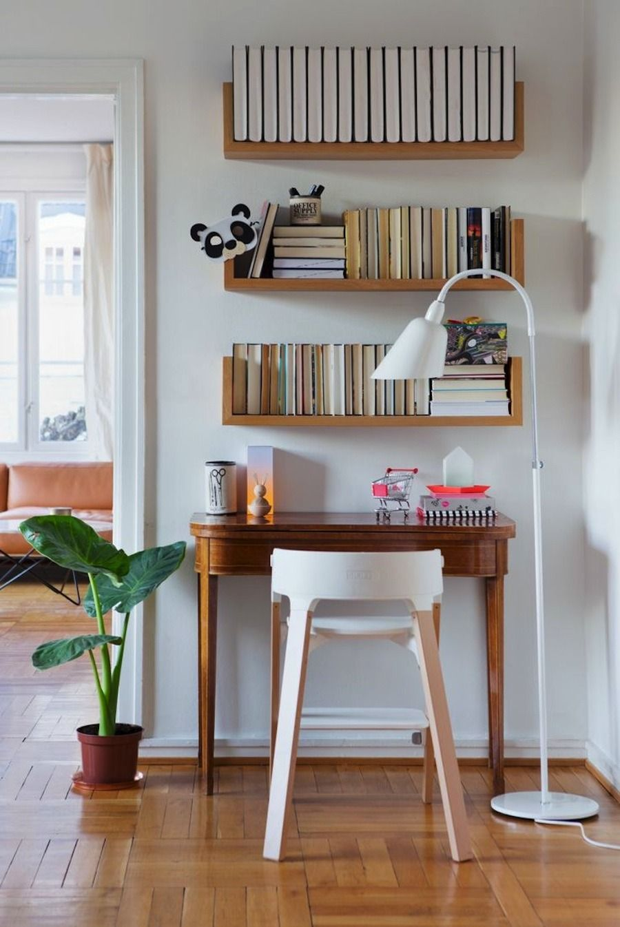 bookshelf above desk storage idea decor small home offices floating shelf over dark wood bookcase diy full wall shelves ornate wooden wrought iron brackets decorative for living