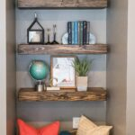 custom floating shelves nook beside the fireplace baskets beneath create additional storage opportunities omaha interior designers wall kmart sylvia park modern living room 150x150