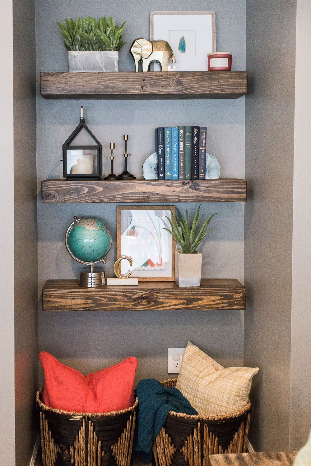 custom floating shelves nook beside the fireplace baskets beneath create additional storage opportunities omaha interior designers wall kmart sylvia park modern living room