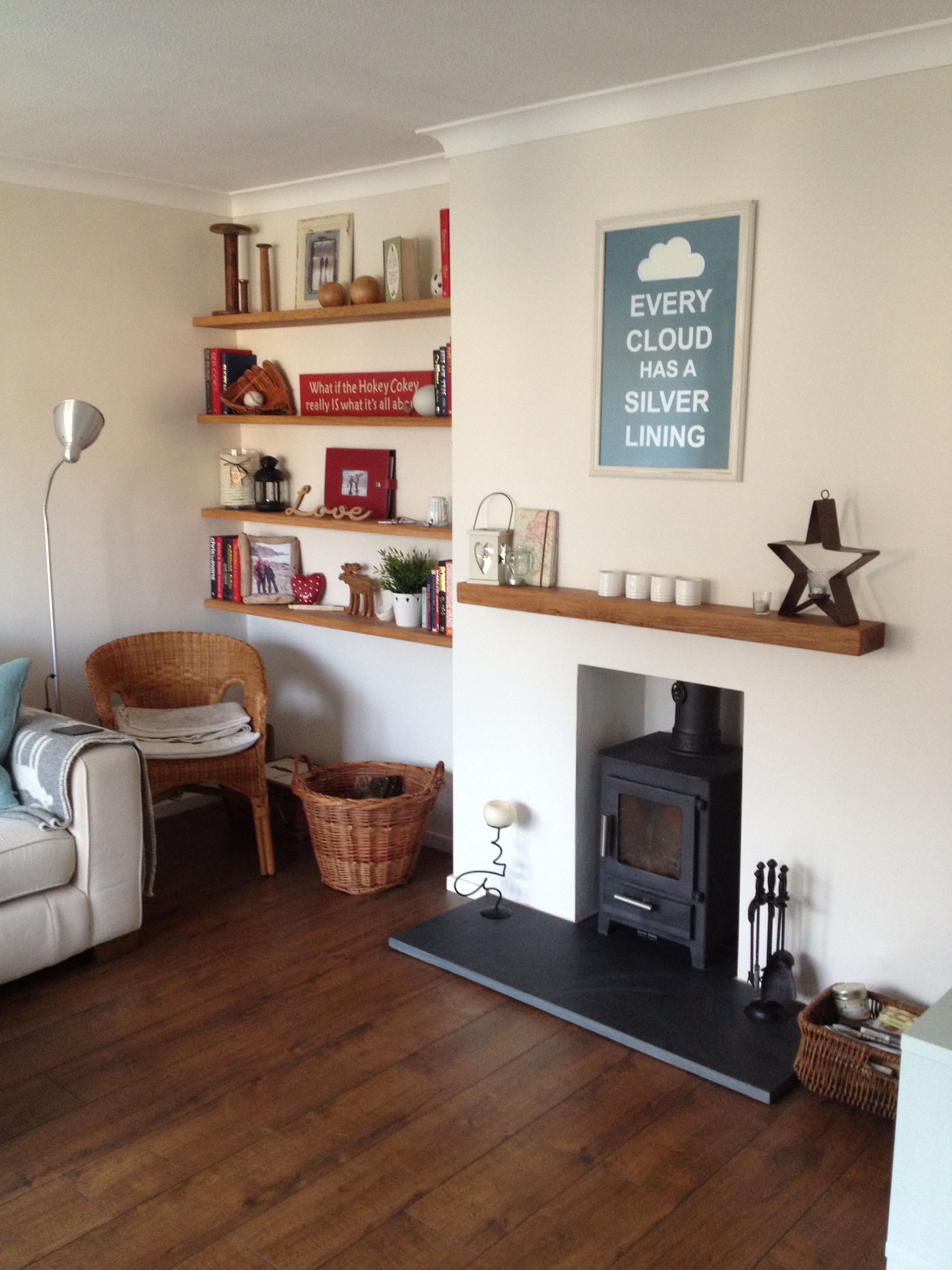 eclectic living room with oak floating shelves and log burner nice fireplace cosy stick wall mirrors single standing shelf for sky box dvd player glass hardware brackets metal