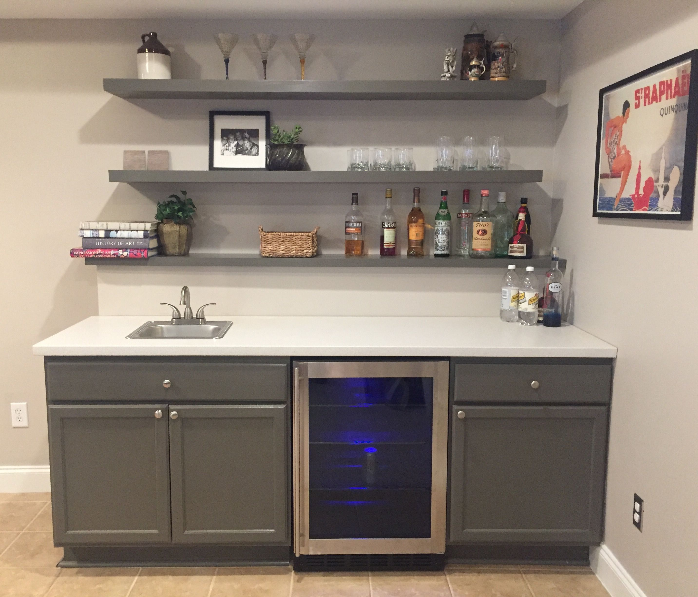 finally finished basement bar unfinished cabinets ikea countertop and floating shelves chairs magnetic secret latch hardware decorative wall for living room bathroom cabinet glass