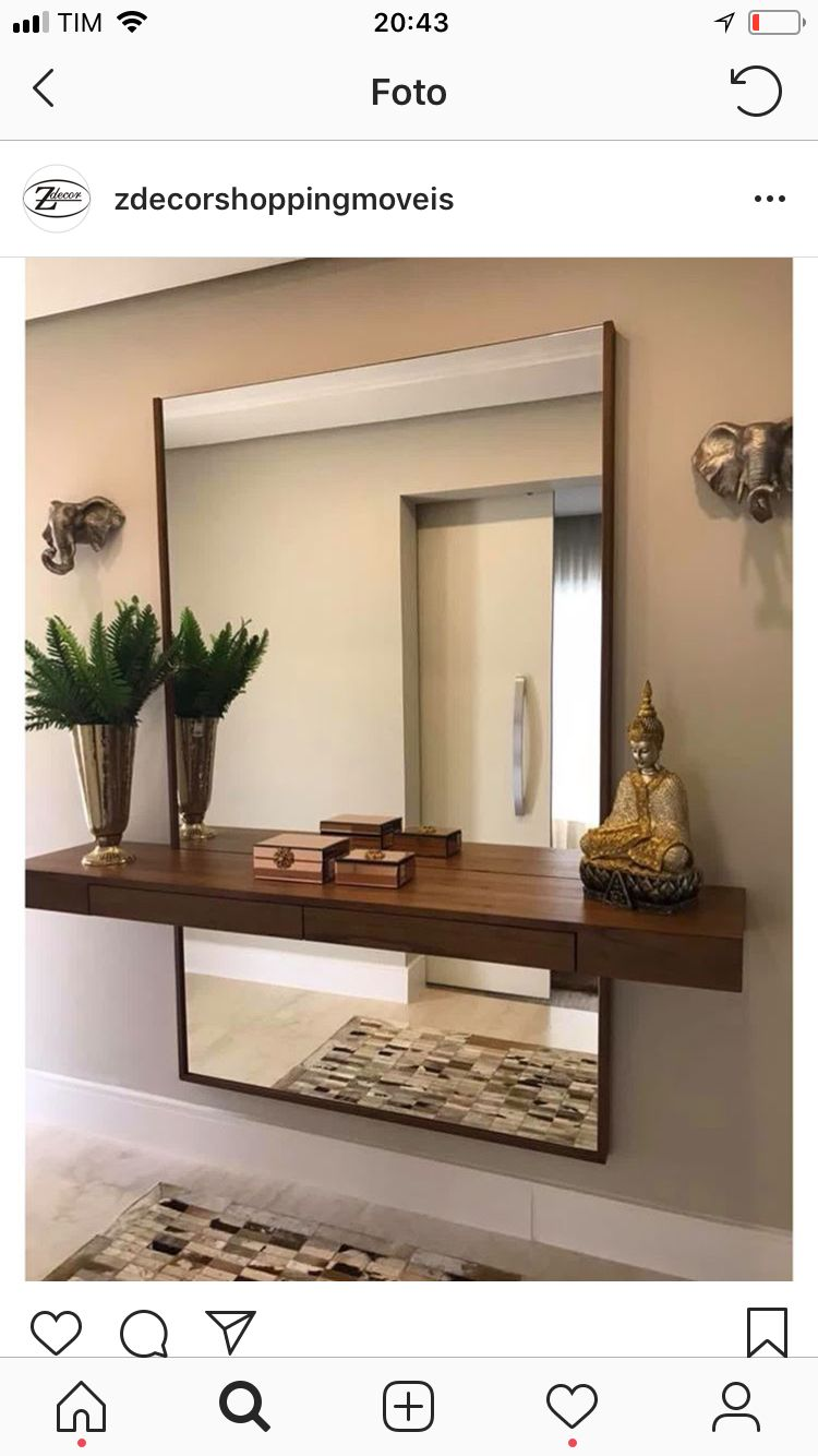 floating shelf and large mirror wall behind exposed above shelves below likely installed entrance home oak bookshelf glass brackets unfinished wood mantel hanging hooks without