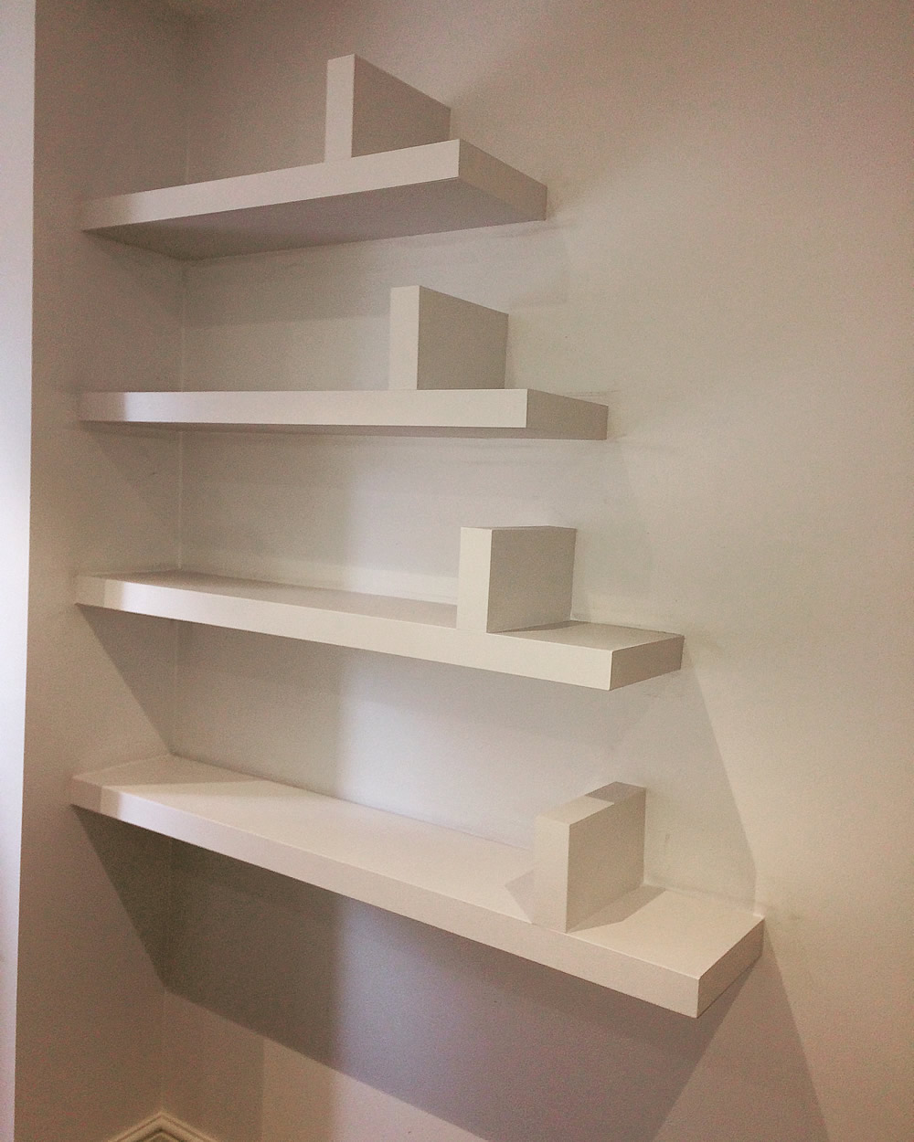 floating shelves with book ends adam whittle shelf bookends gold corner bookshelf ikea bookcase command hooks for hanging plants bedroom closet solutions hardwood fireplace
