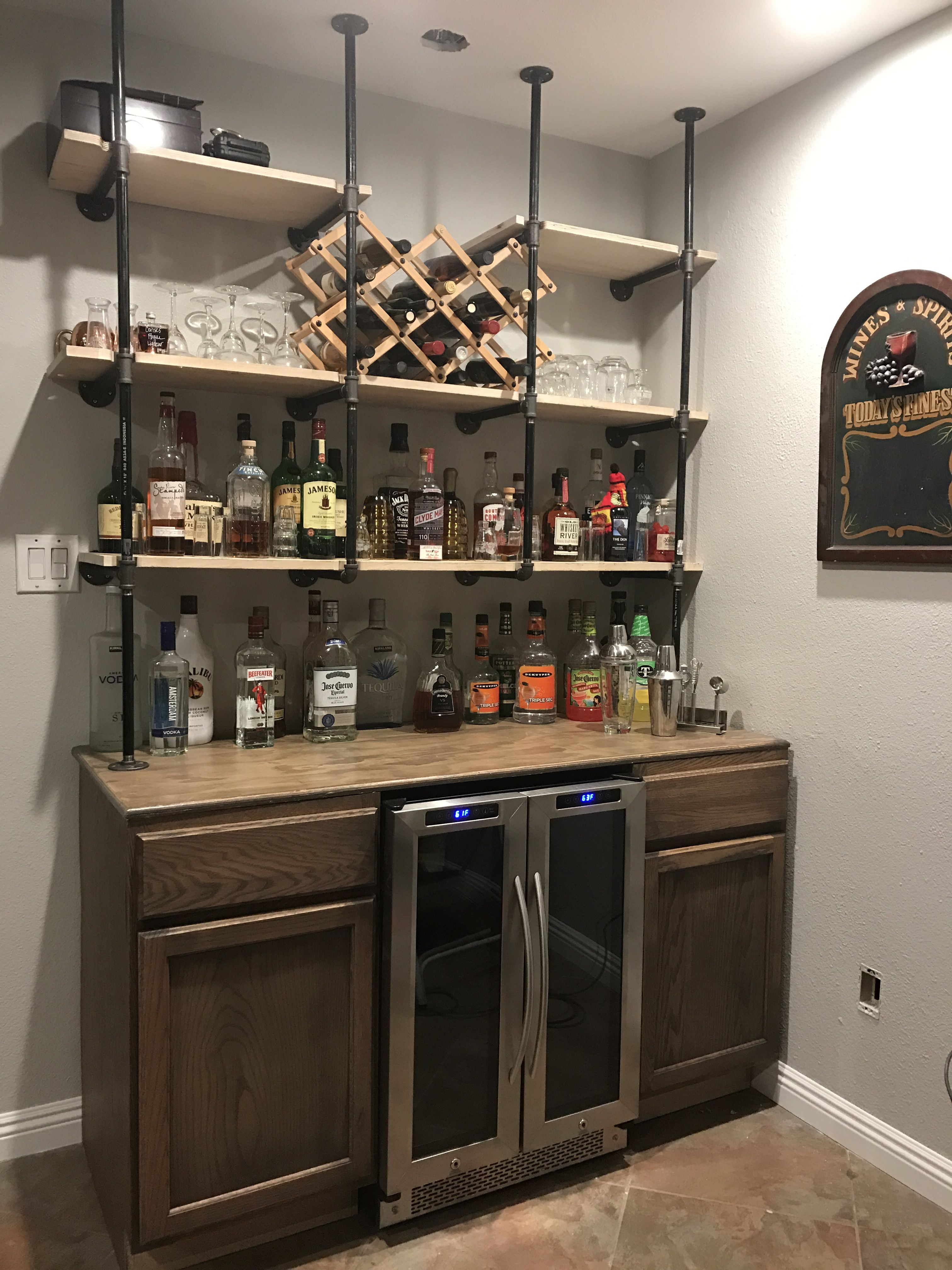 gas pipe shelves over rustic bar basement diy home floating behind old wooden shelving units cream ikea suction cup shower head holder steel support for granite countertop storage