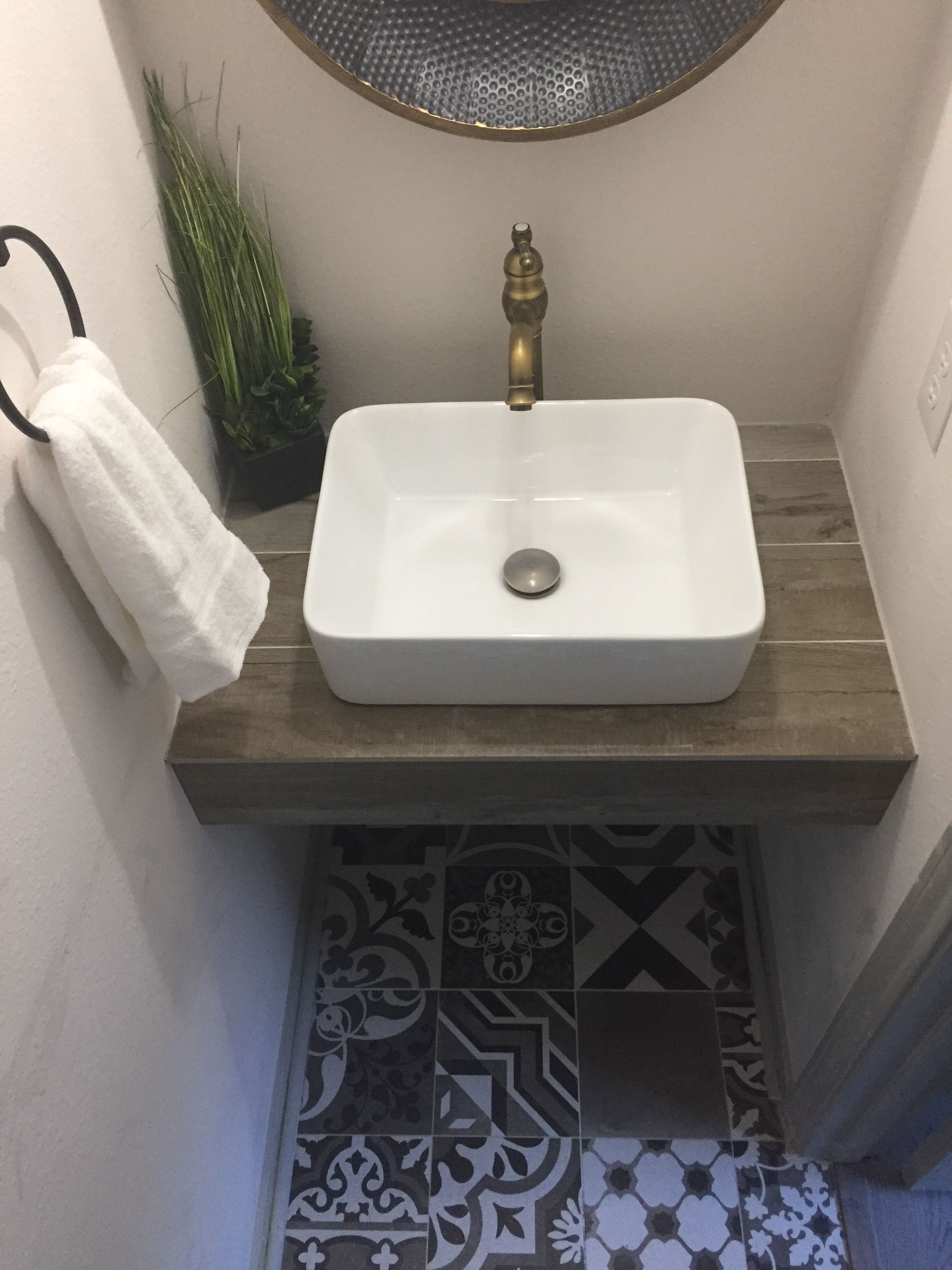 half bathroom remodel new floor tile floating shelf with vessel sink faucet doesn look like otherwise ordinary builders grade anymore metal corner wall bookshelf ideas wood mantel
