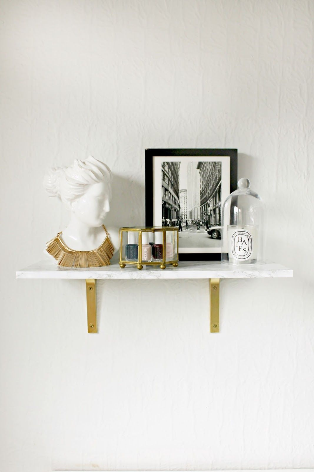 have long been lusting over this marble wall mounted shelf from black floating isn fabulous who doesn love good gold functional element for hall tree coat stand prepac entryway