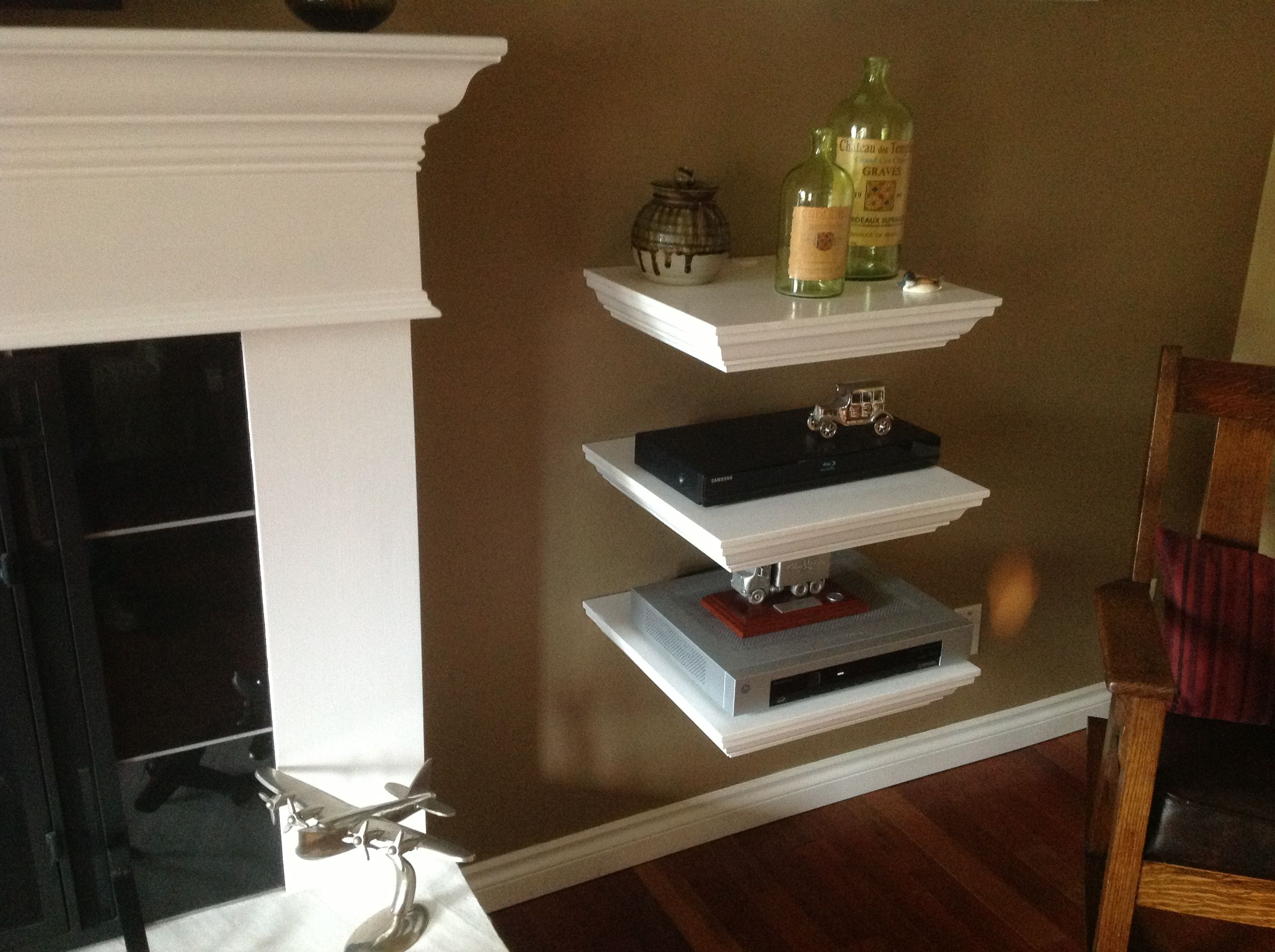 home entertainment shelf system built all cables down into the corner floating for cable box hollow out back large circuit breaker type other side log burner entry bench and