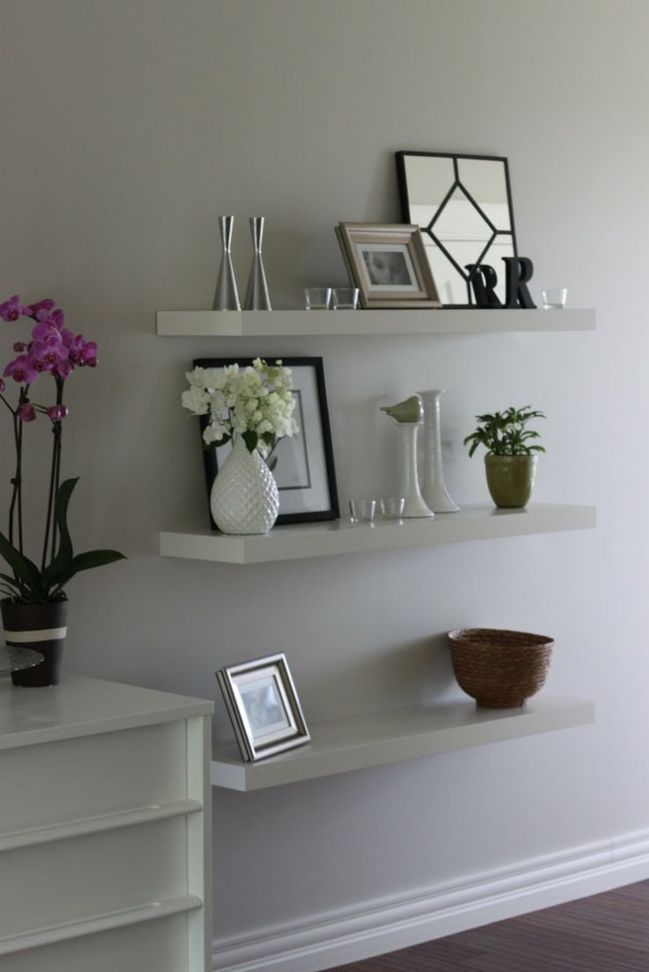 living room black wooden floating shelves with molding white solid wood high gloss nightstand soil plant pots small ceramic decorative vase steel candle holders square table
