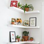 living room white solid wood corner floating shelves brownish plastic plant pots small ceramic flower vase indoor plants decorations black wooden laminate frame painted wall ideas 150x150