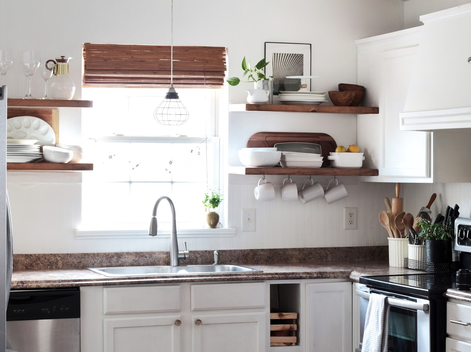 made carli diy kitchen how install floating shelves with open cabinets little over three years ago removed most upper and installed shelving our was one favorite updates quarter