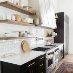 modern mountain home tour great room kitchen dining mod floating shelves cabinets love the ligthing above open statement range hood and black cabinetry vintage rug designed studio 150x150