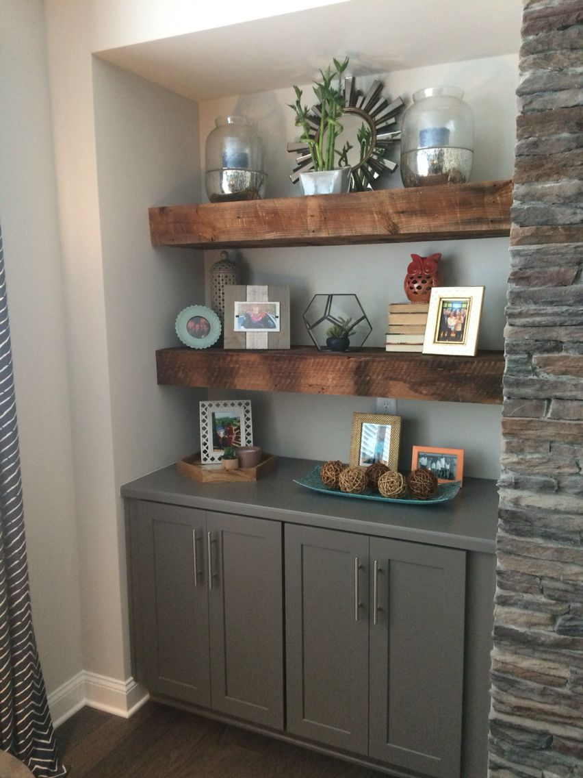 our beautiful reclaimed wood floating shelves flanking fireplace with grey base cabinets located family room bathroom mirror shelf small corner stand white wall baskets stainless