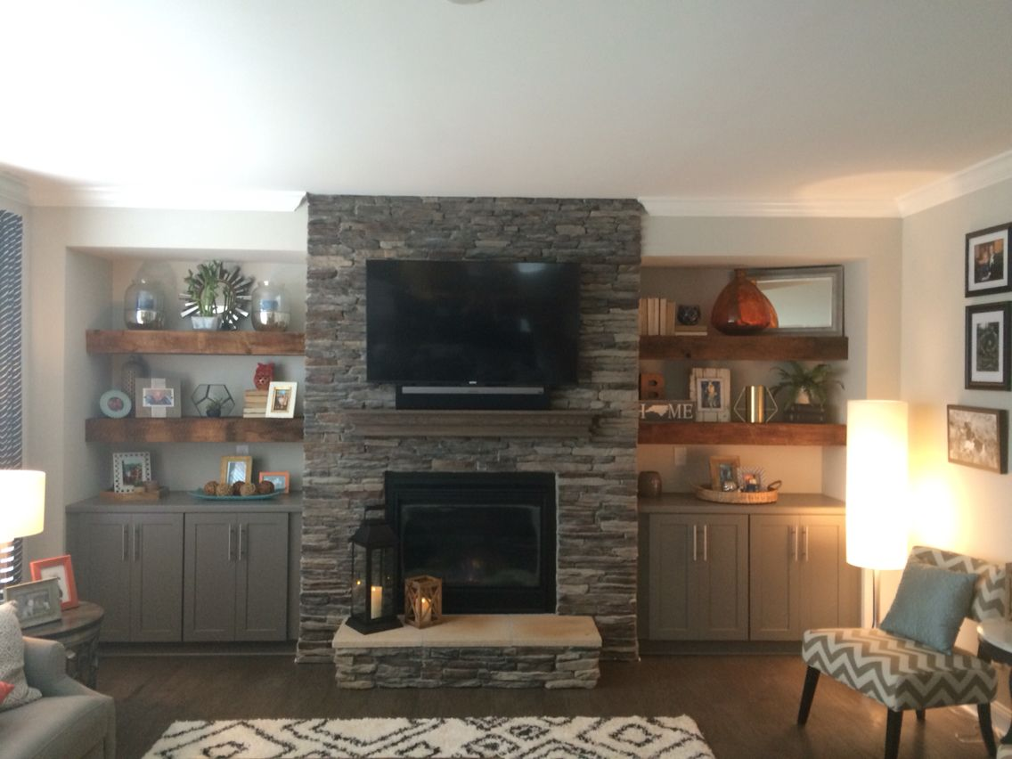 our beautiful reclaimed wood floating shelves flanking stone beside fireplace with grey base cabinets located family room open shelving white feature wall corner computer desk