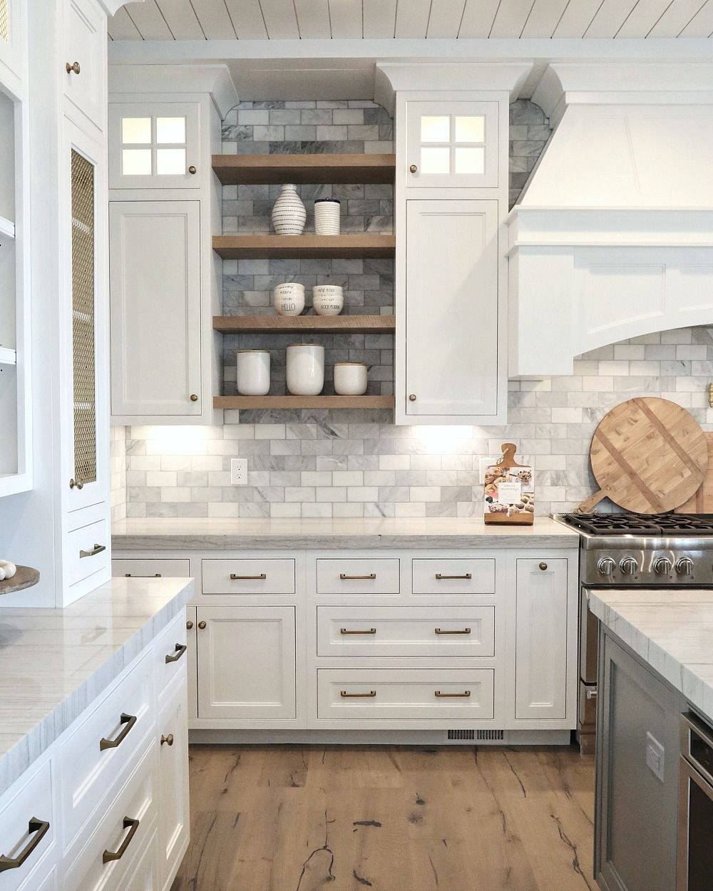 painted kitchen cabinets mixed with wood stained floating shelves between installing peel and stick tiles bathroom shelf support metal pins target wall bookshelves white mounted