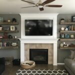 rustic living room barnwood floating shelves shiplap fireplace beside books and decor home sweet husband did the shower screen seal homebase wall desk with walls coat hooks 150x150