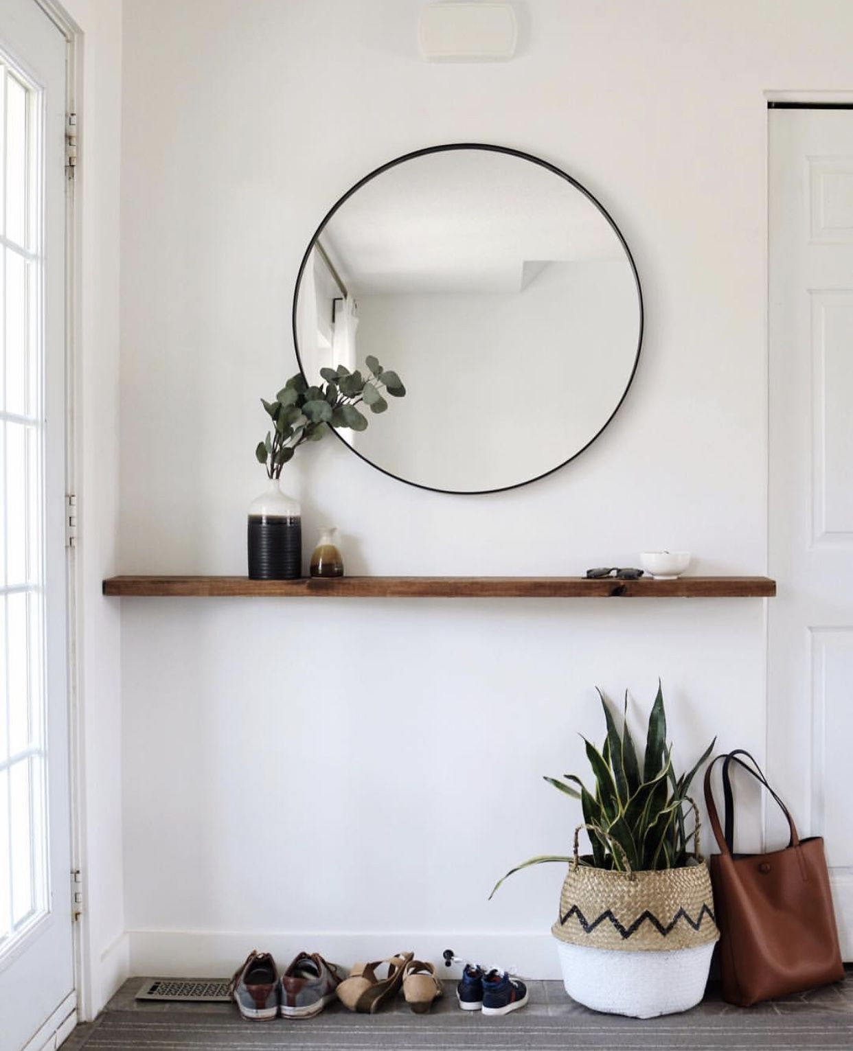 this simple entryway has level elegance with the circular floating shelves for mirror shelf great spot place keys and plant decor item renters kitchen counter cart shadow box
