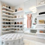 want organize your shoes consider putting them display the white floating shelves for this closet designed lifestyle blogger jessi malay design features her collection shoe rack 150x150