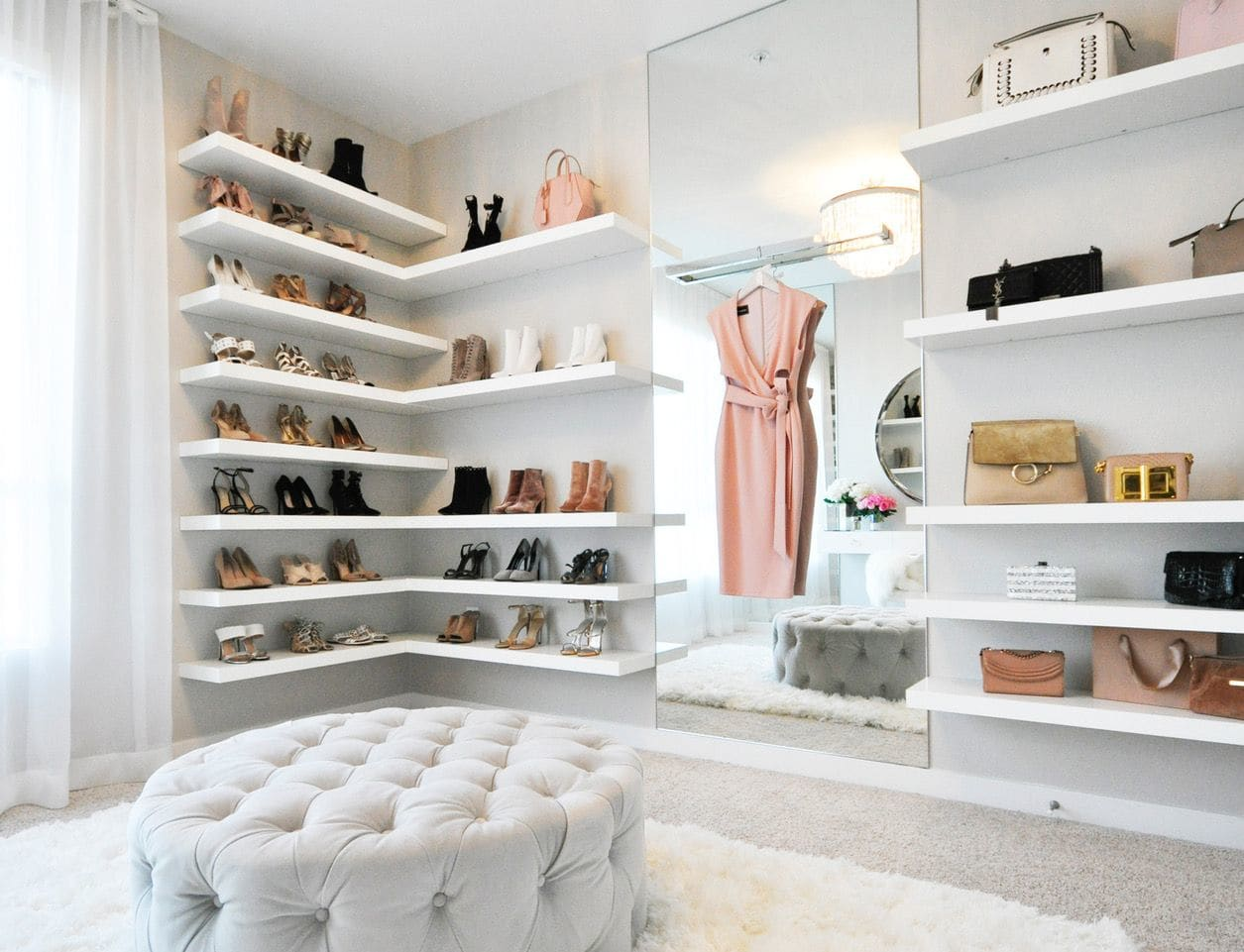 want organize your shoes consider putting them display the white floating shelves for this closet designed lifestyle blogger jessi malay design features her collection shoe rack