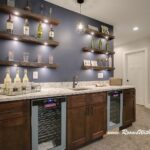 what you think floating shelves homesmsp behind bar this home used above area with dark navy accent wall them the combination creates wow factor for family room and sneaker rack 150x150