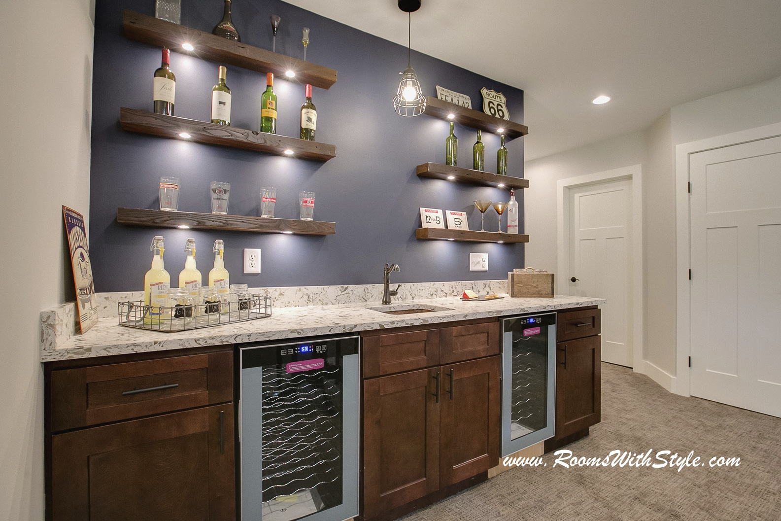 what you think floating shelves homesmsp behind bar this home used above area with dark navy accent wall them the combination creates wow factor for family room and sneaker rack