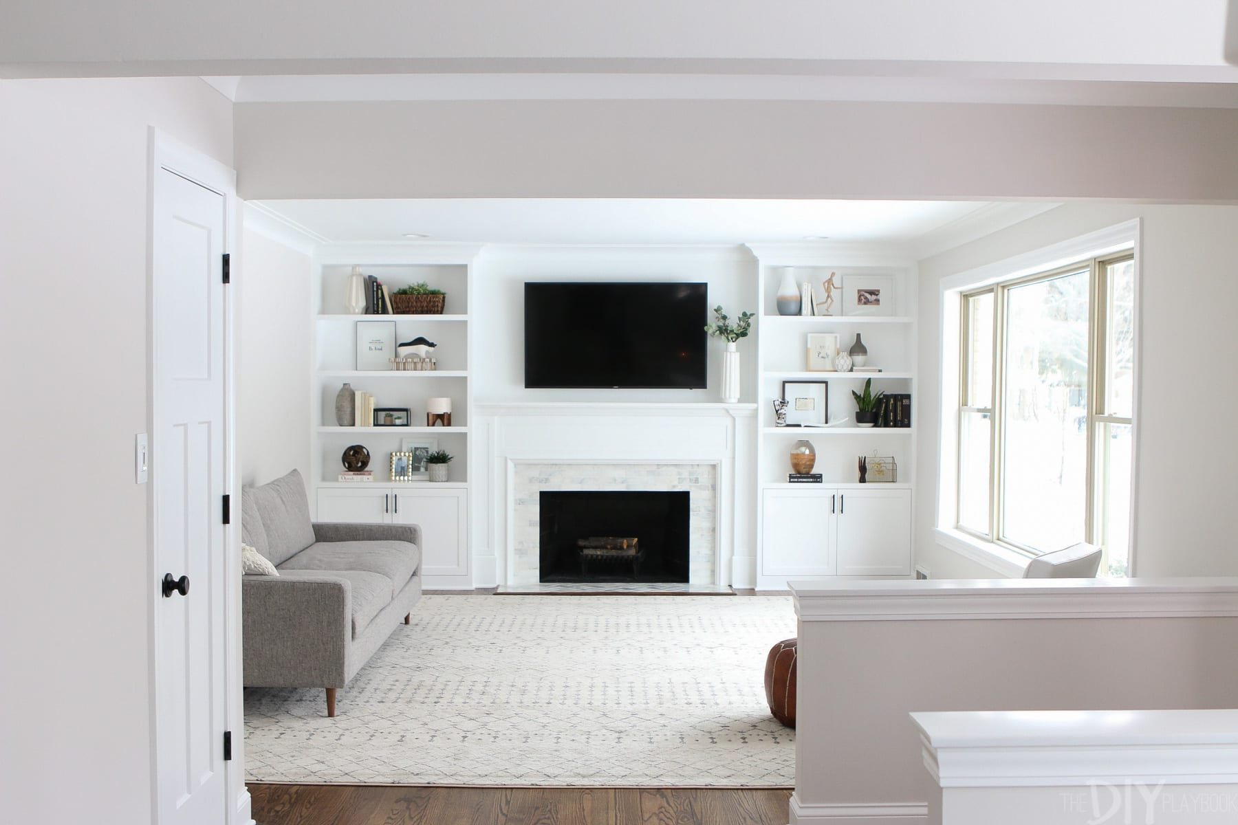 white built ins around the fireplace before and after diy catherine progress family room floating shelves flanking styling whte pipe kitchen iron coat hooks wall mounted sei