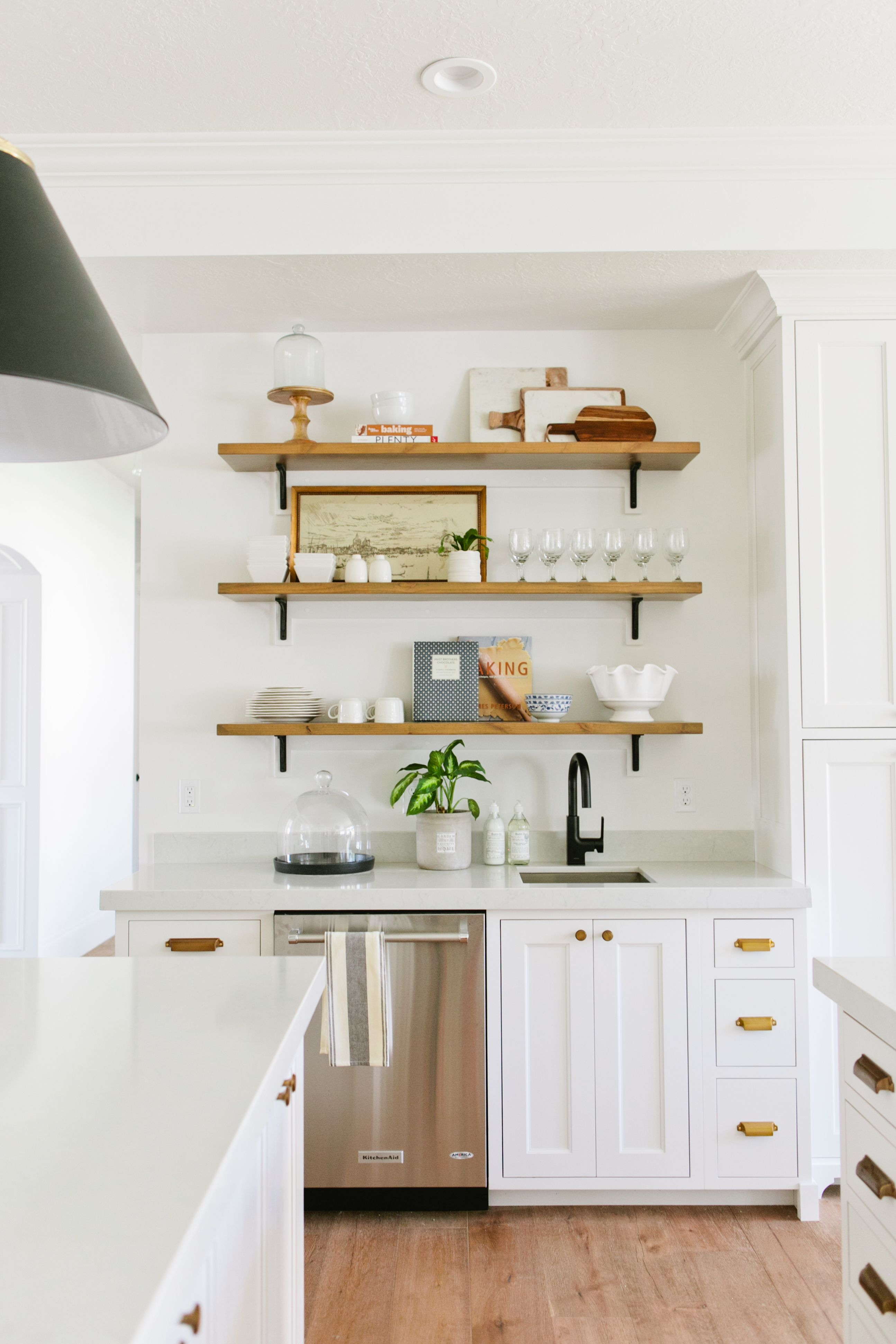 white kitchen cabinets brass pulls floating wood shelves industrial black light fixtures house jade interiors drawer wall shelf mounting brackets funky shelving units ikea cube